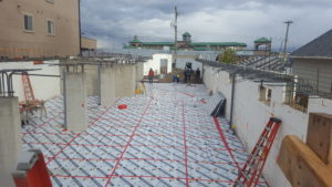 Subterra providing a thermal break under a parkade slab for a mid-rise building.