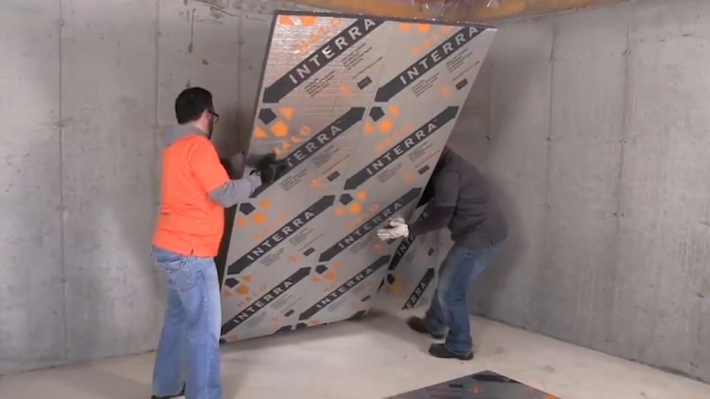 male construction workers installing Halo® Interra® to concreate wall