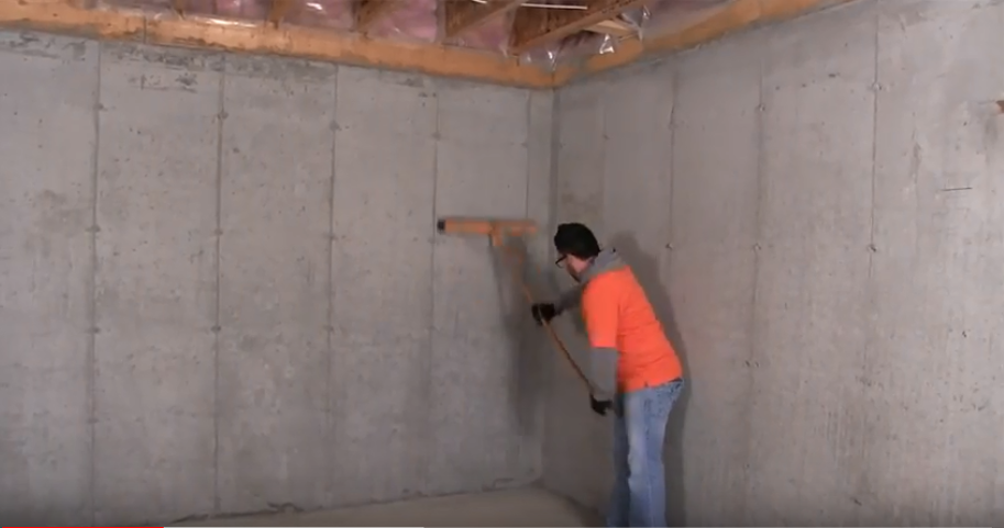 male construction worker cleaning off a concrete wall before installing Halo®