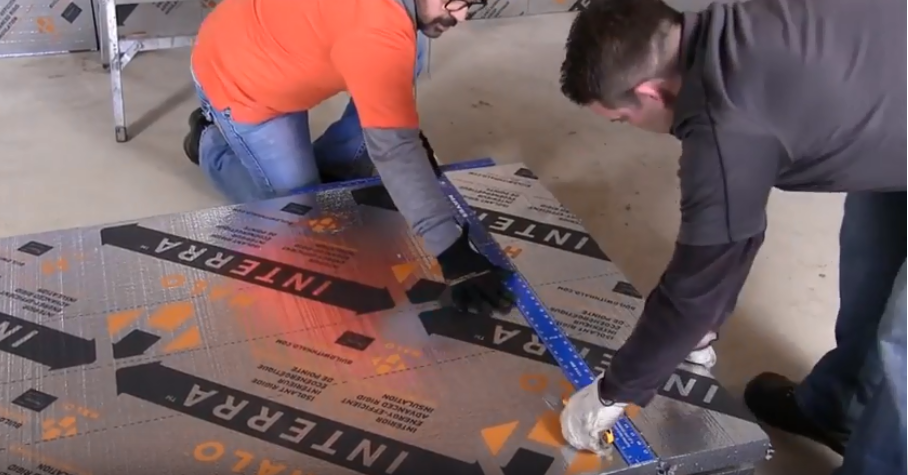 two male construction workers measuring Halo® Interra® before installation